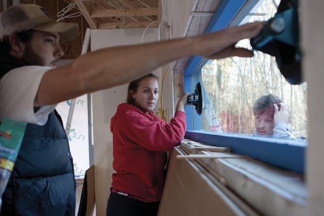 Students installing custom-made windows