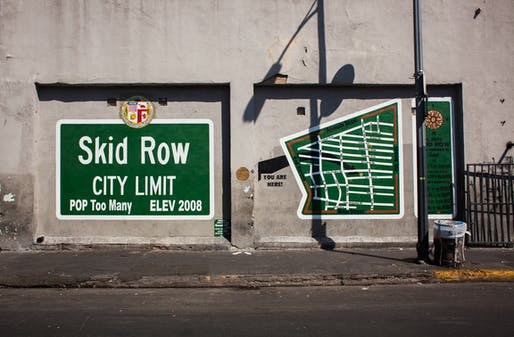 A mural in Skid Row, an area of LA that has traditionally been home for much of the city's homeless population but which is currently gentrifying. Image via wikimedia.org