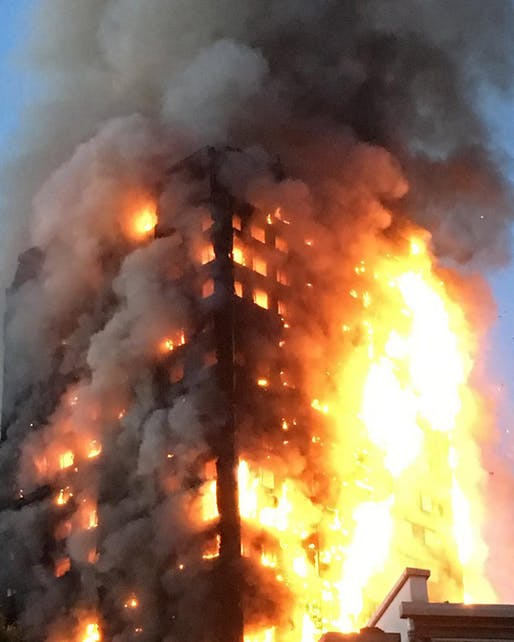 The 24-story Grenfell Tower completely engulfed in flames as the sun rises over London on Wednesday morning. Image via @mrgeorgeclarke on Instagram.
