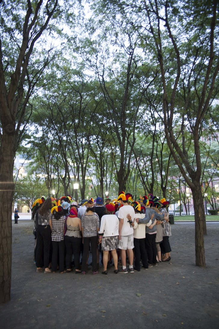 At sundown, nearly 100 members of the public gathered in Metrotech Plaza for the climax of the penultimate day of 'When I Left the House it Was Still Dark' in New York City, in 2013. Scene choreographed by Jen Harmon and organized by Ariel Abrahams. Photograph by Ayden L.M. Grout.