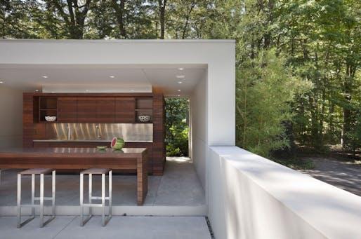 Outdoor kitchen in New Canaan Residence by Specht Harpman