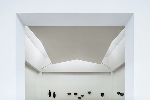 Another gallery, with a suspended concrete ceiling hiding the light's source - photo by Amit Geron
