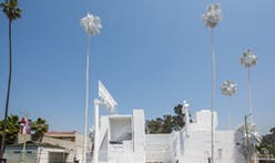 Artist bedecks decrepit Bates Motel in ghost-white before eventual demolition