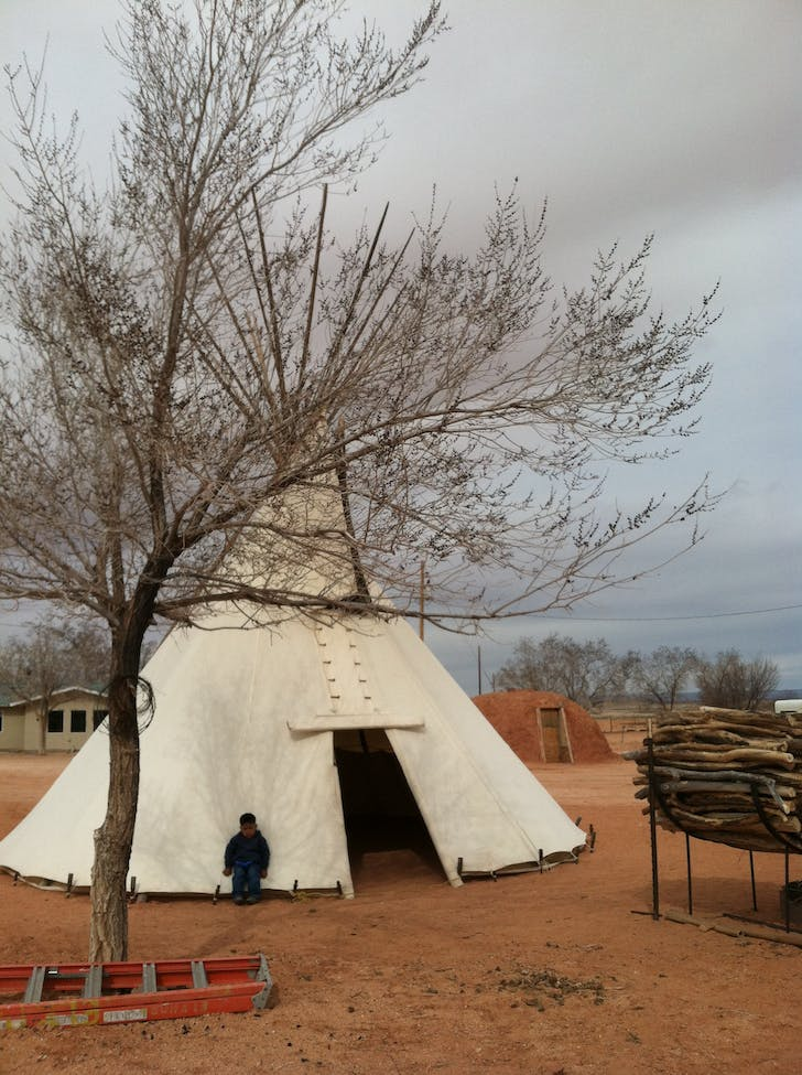 Tipi, Hogan, and HUD-built track housing next to Rabbit Ear House, Navajo Nation, Utah, 2012. Image courtesy of Dialectic.