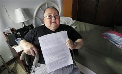 Disabled resident of Harbor Manor Robert Rosenberg displays a letter sent to him by FEMA asking for repayment for disaster aid. Credit: AP / Kathy Willens