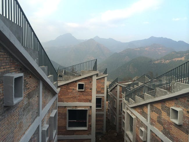 Stepped roofs designed to be planted with gardens on top of Jintai Village houses. / Rural Urban Framework (RUF), the 2015 Curry Stone Design Prize winner.