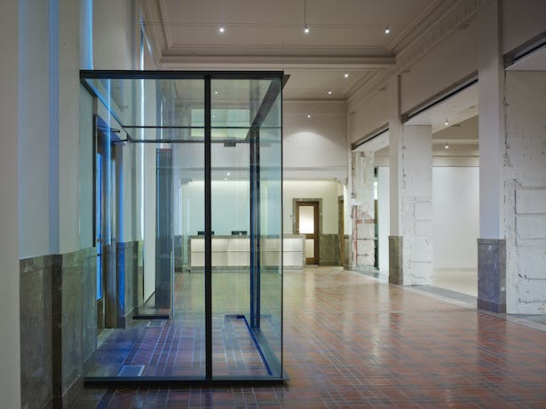 The original drawings showed a vestibule in the building. It was never built. The new glass and steel vestibule clearly states a 21st Century change.