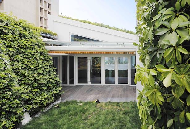 External green walls blend with green roof