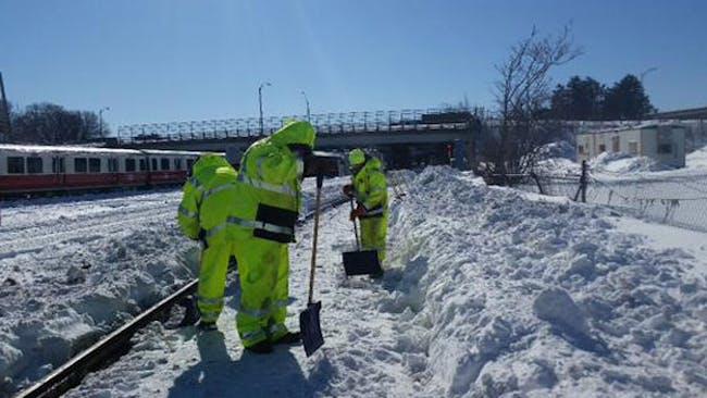 MBTA workers shovel snow in Boston. Credit: MBTA