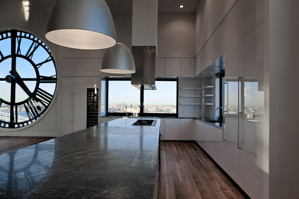 GLAM Kitchen - the cabinetry edges, as well as the refrigerator door, the wine cooler and the upper cabinets are mitered at 45-degree angles with all side panels, creating flat planes and clean lines