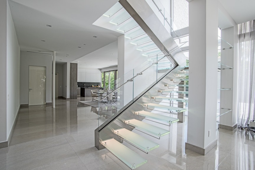 High Quality Complementing Elements Of Brushed Stainless Steel Surround The Starphire  Glass Railings
