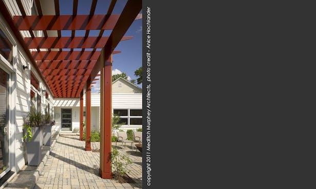 Pergola shading the south-facing patio doors