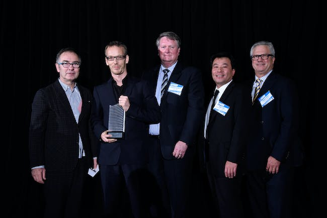 IIT Dean of Architecture Wiel Arets (left) presents the team from One Central Park with the Best Tall Building Worldwide trophy. From L to R: Wiel Arets, Illinois Institute of Technology; Bertram Beissel, Ateliers Jean Nouvel; Michael Goldrick, Frasers Property; Toru Abe, Sekisui House Australia Pty Ltd; and Robert Bird, Robert Bird Group.