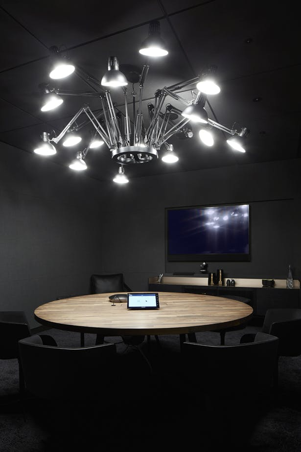 Private meeting rooms with contemporary lighting