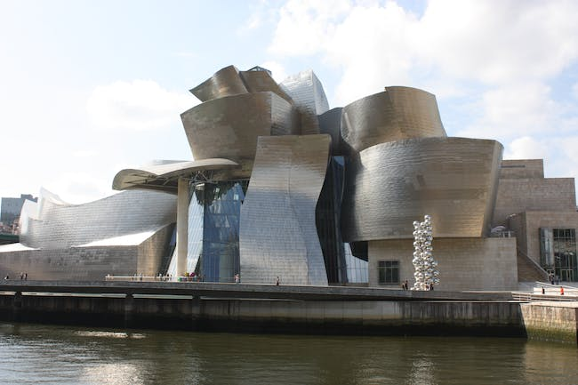 The Guggenheim Museum in Bilbao is credited with regenerating the Basque city and creating a new template for museum-design. But are its effects on art good as well? Credit: Wikipedia