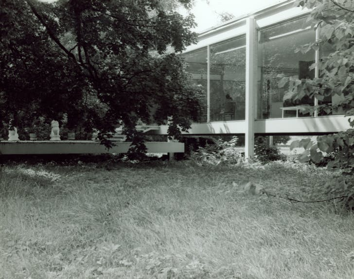 Farnsworth House, exterior, view of south façade and east end of terrace with Farnsworth's sculptures. Undated. Photo by Gorman's Child Photography. Courtesy and copyright of Newberry Library, Chicago, Illinois.