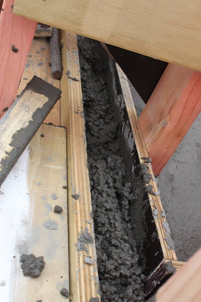 The 90mm side lip of the concrete slab foundation - the walls will connect to this