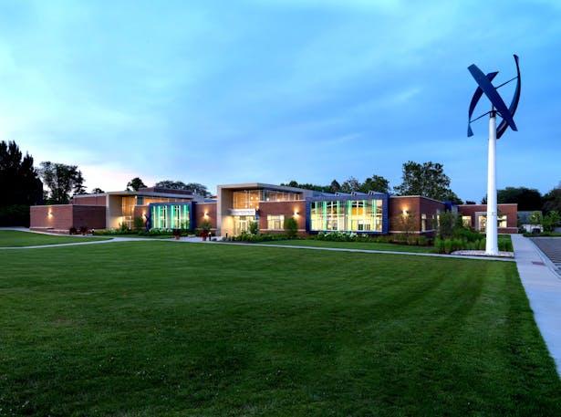 Evening View with Wind Turbine: The John C. Dunham STEM Partnership School, Cordogan Clark & Associates
