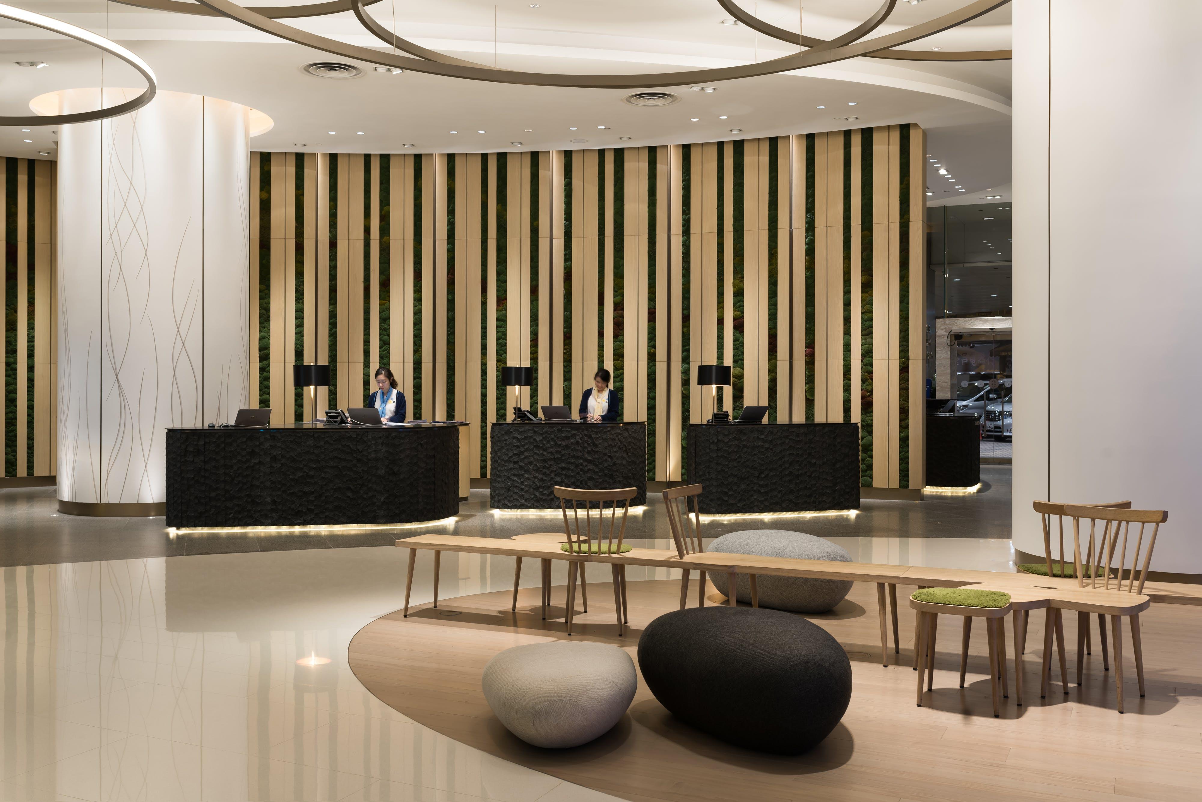 Aedas Interiors creates a minimal aesthetic with sculptural forms