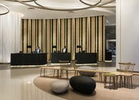 Aedas Interiors creates a minimal aesthetic with sculptural forms for Novotel Century Hong Kong's high traffic lobby