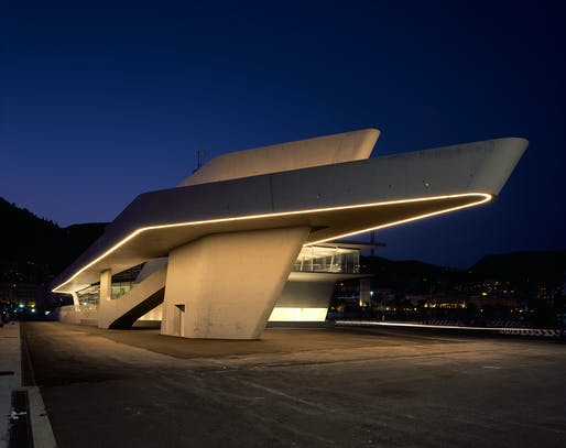 The terminal's exterior at night. Image credit: Helene Binet / courtesy of Zaha Hadid Architects