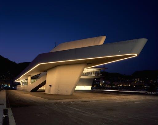 The terminal's exterior at night. Image credit: Helene Binet / courtesy of Zaha Hadid Architects