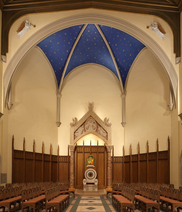Sactuary Transept features wood-grained plaster wainscot and moldings adorned with marbleized plaster heraldic angels under a starry night sky