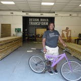 Studio H student Jamesha Thompson with a bike she built herself, with help from Studio H instructor Matthew Miller. From IF YOU BUILD IT, a Long Shot Factory Release 2013.