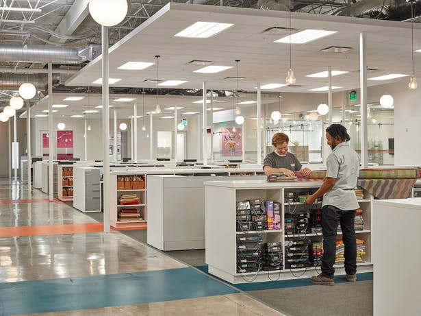 Custom designed work islands located throughout the space provide a perfect mix of storage and collaborative space. In addition, the islands house hidden printing stations to help keep the space clutter free.
