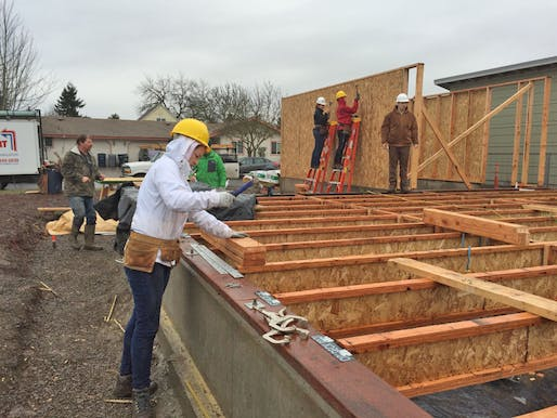 "Students finish floor joists during the OregonBILDS studio in January 2016 in west Eugene. ""Very few other—if any—housing programs address housing design education in a comprehensive manner,"" says Professor Michael Fifield. Photos courtesy OregonBILDS. This is the third house UO students have built during the OregonBILDS program."