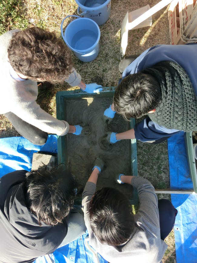 Testing concrete mixes at the Keio workshop. Courtesy of Bill Galloway