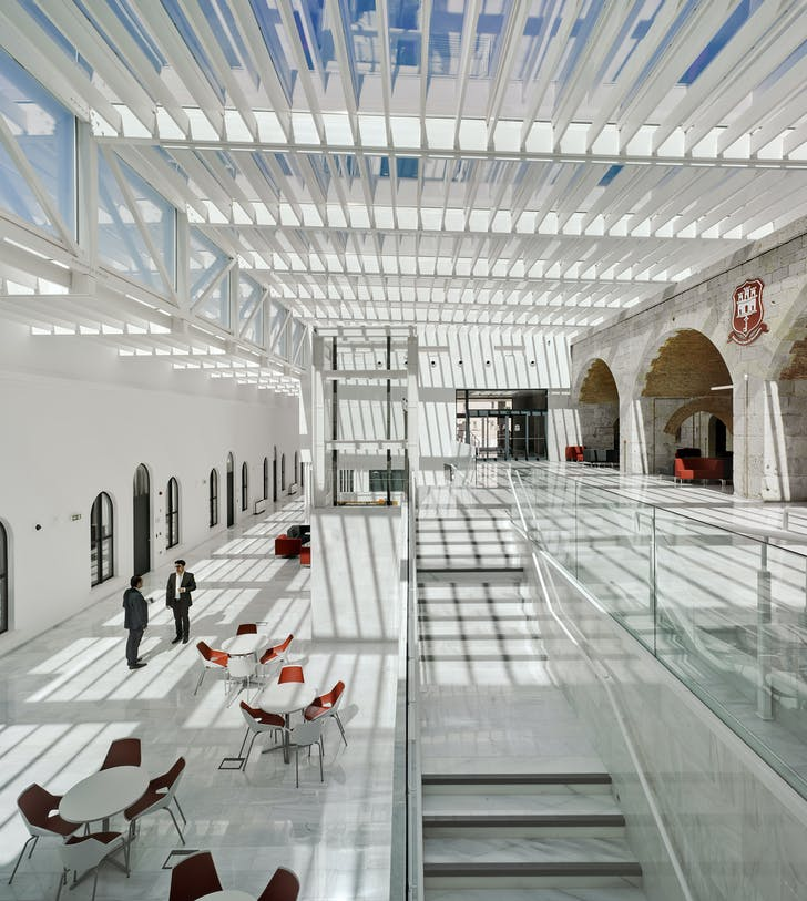 The atrium of Gibraltar University combines a mix of historical character and modern elements