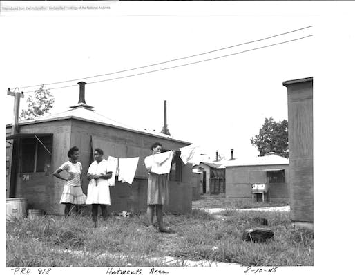African American women hanging laundry in a hutment area, Oak Ridge, CA, 1945. Image: by Edward Westcott. National Archives and Records Administration.