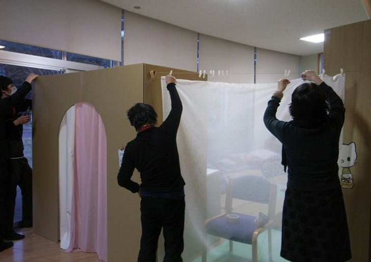 Tanohata Village Temporary Booth designed by Nobukai Furuya with Yoko Ando's curtains (courtesy earthmanual.org).