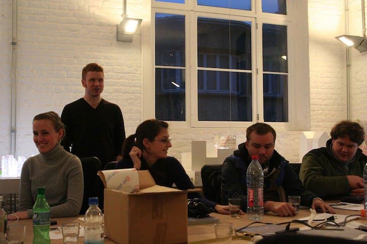 Jason Scroggin in back, UK/CoD Assistant Professor of Architecture