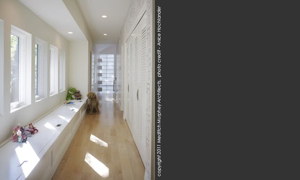 Upstairs hall way with window seat - airy, light-filled and with a great view of the adjacent park.