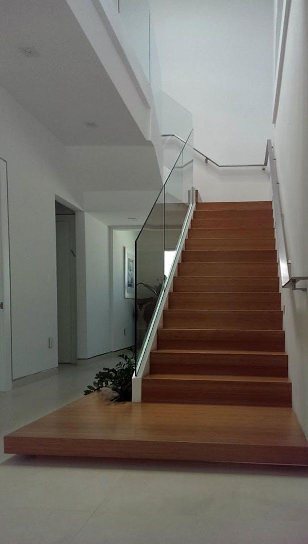 Sleek Glass Railings in Aventura Home | Bella Stairs, LLC | Archinect