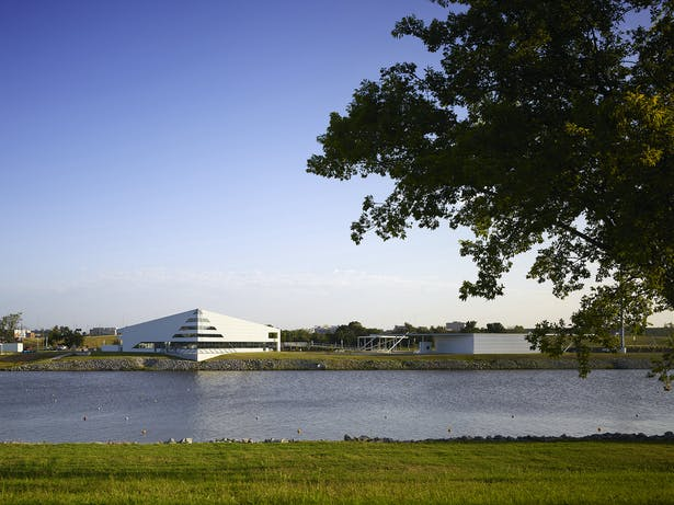 Main Building and raft building viewed from the south side of the Oklahoma River.