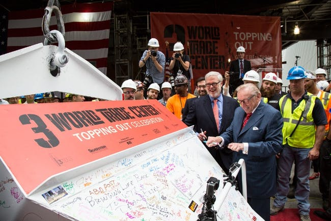Silverstein Properties Chairman Larry A. Silverstein (right) and Port Authority of New York & New Jersey Executive Director Pat Foye at the topping out ceremony signing the final bucket of concrete. (PRNewsFoto/Silverstein Properties)