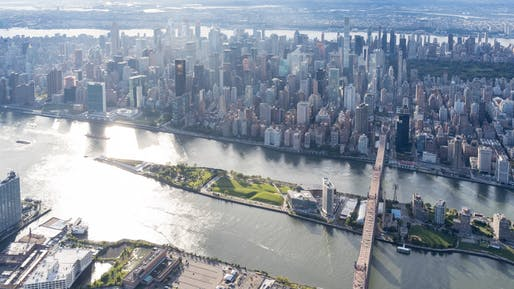 Aerial view of Roosevelt Island, Cornell Tech, and its context in the East River between Manhattan and Queens; 2017. Photo © Iwan Baan.