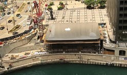 A giant MacBook tops out the Foster + Partners-designed Chicago Apple Store