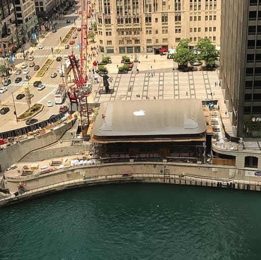 A snap taken just before the construction workers centered the logo on top of the new Chicago Apple Store. Image: @korieeman via Instagram
