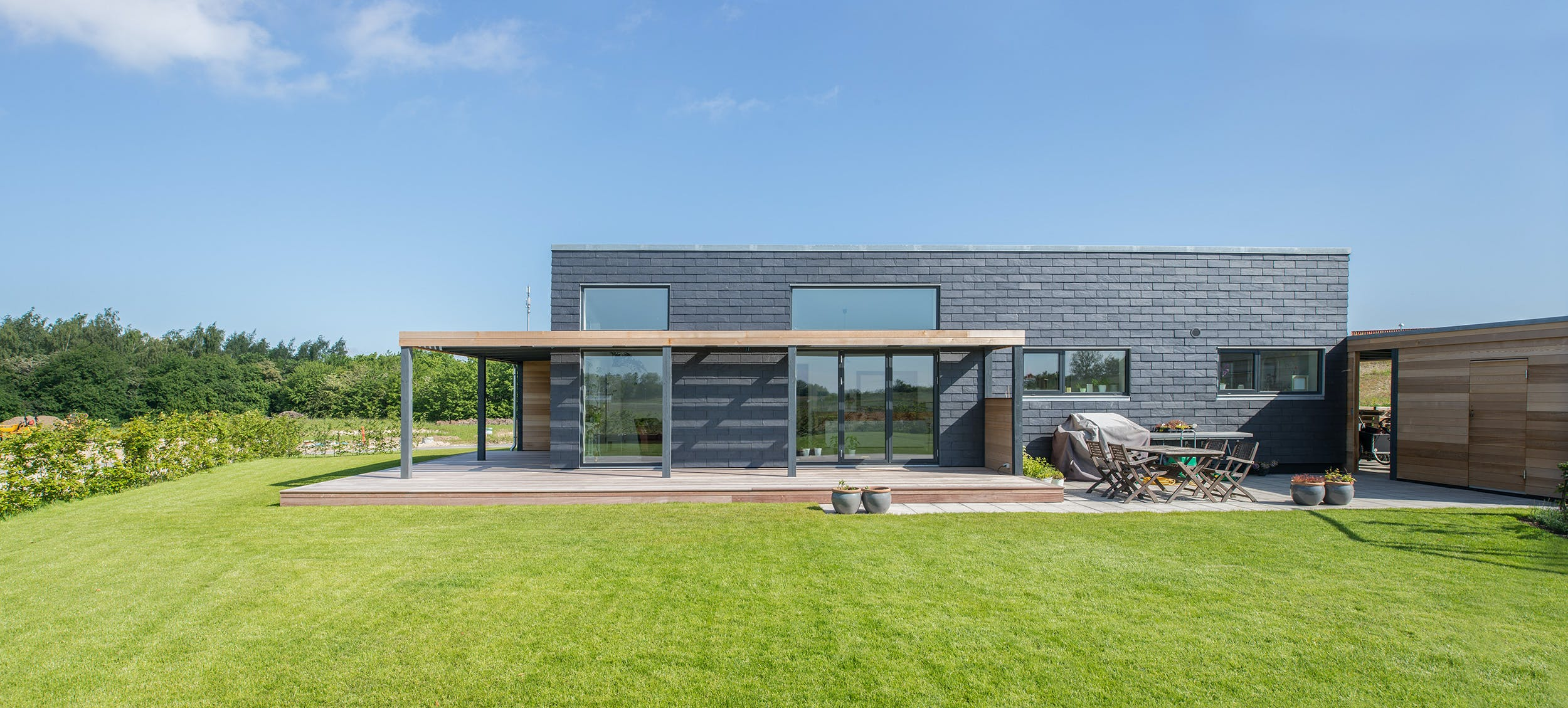 Sustainable slate tiles dress this Danish family\'s energy ...
