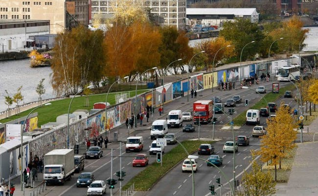 A 1.3-kilometer (0.8-mile) stretch of the Berlin Wall, the world's longest open-air art gallery, was decorated by 118 artists from 21 countries in 1990. (image via spiegel.de)