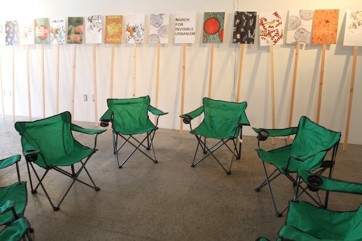 Camp chairs and picket-signs set up for GRNASFCK's exhibition 'I love extremophiles!' Credit: GRNASFCK