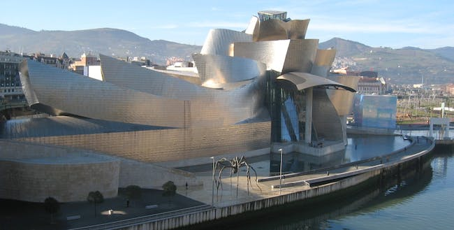 Guggenheim Museum in Bilbao, designed by medalist Frank Gehry (Photograph taken by user MykReeve via Wikimedia Commons)