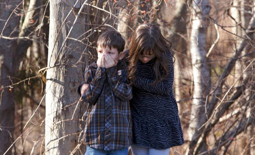 Young children wait outside Sandy Hook Elementary School after a shooting in Newtown, Connecticut, December 14, 2012. A shooter opened fire at the elementary school in Newtown, Connecticut, on Friday, killing dozens including children, the Hartford Courant newspaper reported. REUTERS/Michelle McLoughlin
