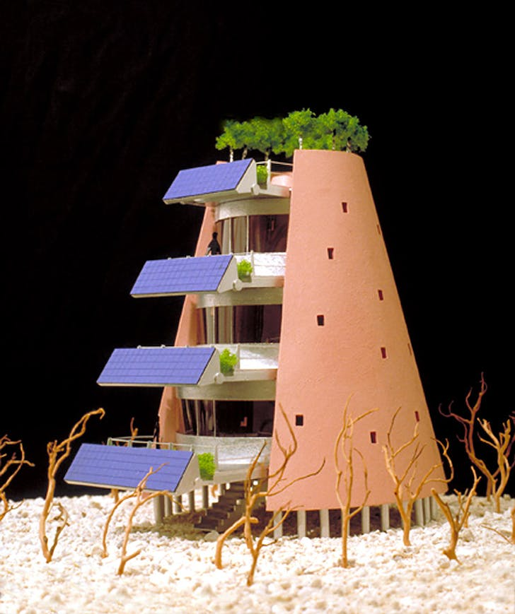 The Solar Electric Desert House designed in 1995: a large adjustable( to accommodate changing sun angles) array of photovoltaic cells are mounted on the front of multi-level exterior deck spaces. The structure also has a group of trees planted around the top deck.