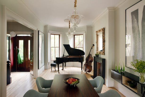 View of Music Room, front door vestibule, and dining area at front of house.