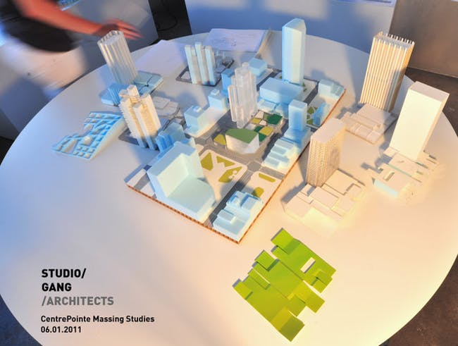 A scale model, center, of a section of downtown Lexington shows one of the raw concepts for the CentrePointe block. Circling it are models of several alternative ideas that Studio Gang Architects will show at a public meeting Thursday. The site models include combinations of high-rise and low-rise buildings.
